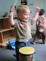 Child plays drum set